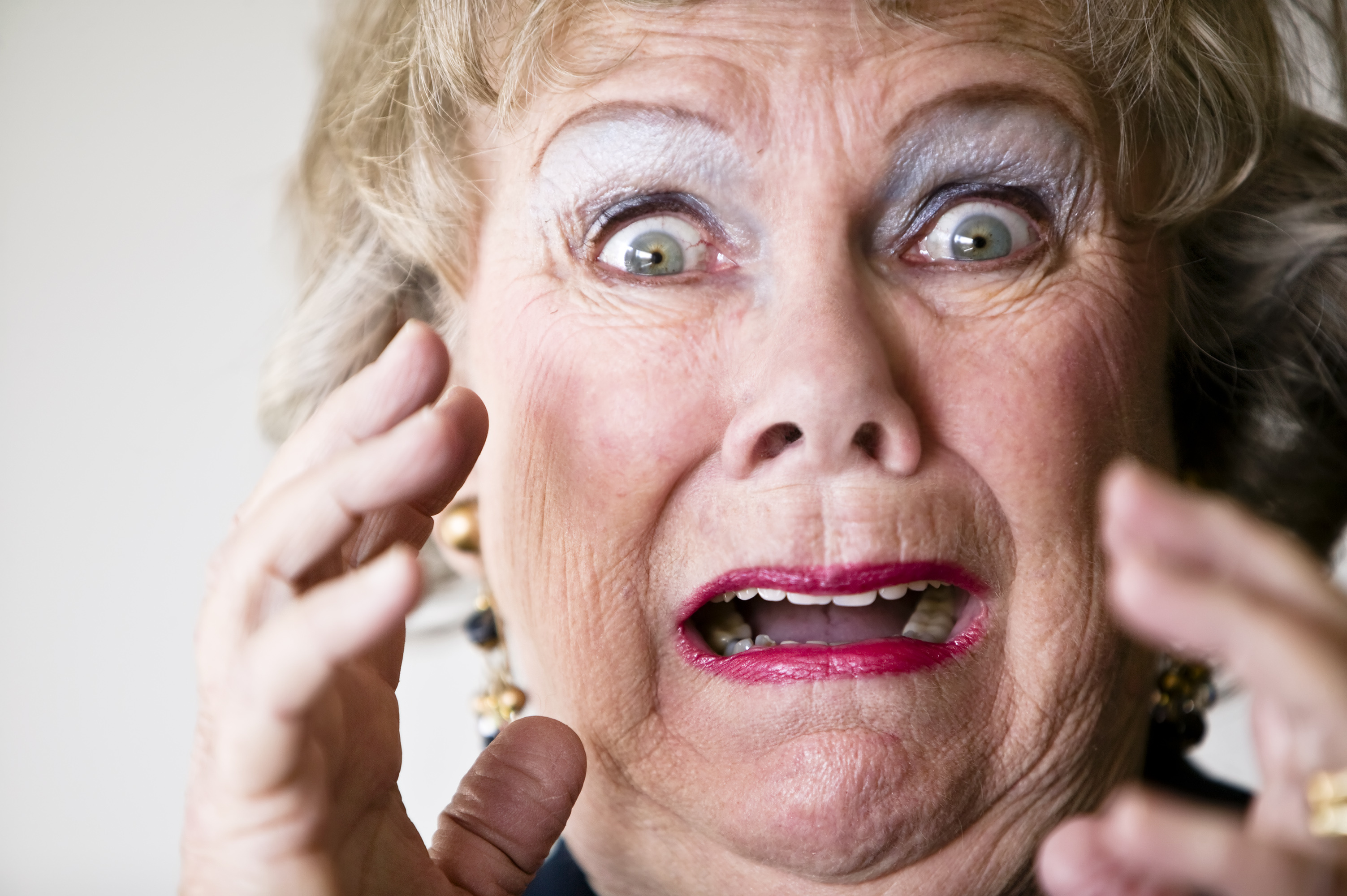 Close up of a senior woman with her mouth open Stock Photo